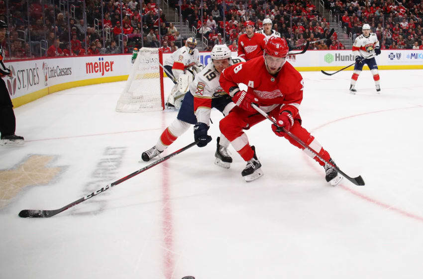 DETROIT, MICHIGAN - DECEMBER 22: Justin Abdelkader #8 of the Detroit Red Wings battles for the puck with Mike Matheson #19 of the Florida Panthers during the second period at Little Caesars Arena on December 22, 2018 in Detroit, Michigan. Florida won the game 2-1. (Photo by Gregory Shamus/Getty Images)