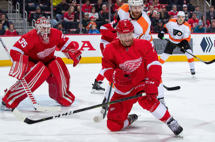 DETROIT, MI - FEBRUARY 17: Nick Jensen #3 of the Detroit Red Wings attempts to block a shot in front of teammate Jimmy Howard #35 during an NHL game against the Philadelphia Flyers at Little Caesars Arena on February 17, 2019 in Detroit, Michigan. Philadelphia defeated Detroit 3-1. (Photo by Dave Reginek/NHLI via Getty Images)