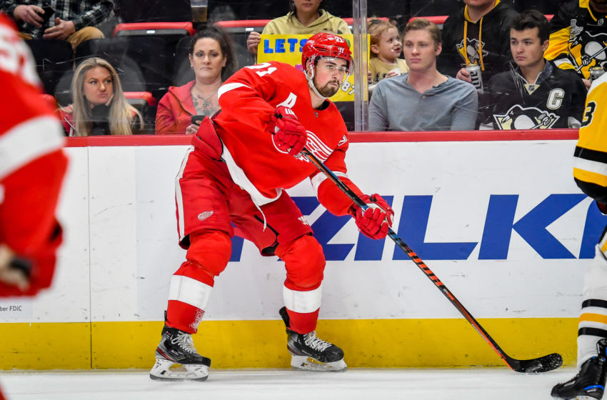 DETROIT, MI - APRIL 20: Detroit Red Wings center Dylan Larkin (71) passes along the boards during the Detroit Red Wings game versus the New York Islanders on March 16, 2019, at Little Caesars Arena in Detroit, Michigan. (Photo by Steven King/Icon Sportswire via Getty Images)