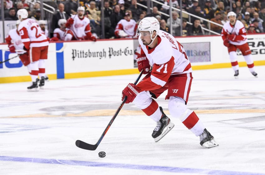 PITTSBURGH, PA - APRIL 04: Detroit Red Wings Center Dylan Larkin (71) skates with the puck during the third period in the NHL game between the Pittsburgh Penguins and the Detroit Red Wings on April 4, 2019, at PPG Paints Arena in Pittsburgh, PA. (Photo by Jeanine Leech/Icon Sportswire via Getty Images)