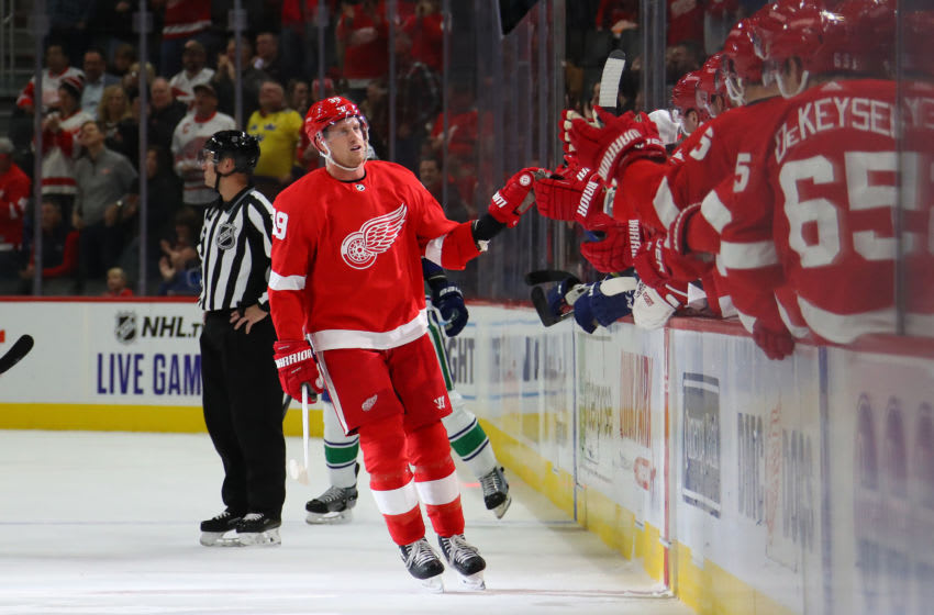 DETROIT, MICHIGAN - OCTOBER 22: Anthony Mantha #39 of the Detroit Red Wings celebrates his first period goal with teammates while playing the Vancouver Canucks at Little Caesars Arena on October 22, 2019 in Detroit, Michigan. (Photo by Gregory Shamus/Getty Images)
