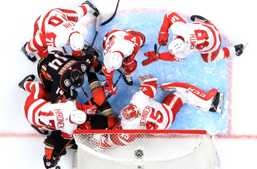 ANAHEIM, CALIFORNIA - NOVEMBER 12: Christoffer Ehn #70, Jonathan Bernier #45, Madison Bowey #74 and Filip Hronek #17 of the Detroit Red Wings defend against Adam Henrique #14 and Rickard Rakell #67 of the Anaheim Ducks during the first period of a game at Honda Center on November 12, 2019 in Anaheim, California. (Photo by Sean M. Haffey/Getty Images)