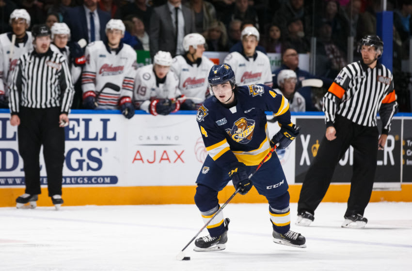 OSHAWA, ON - NOVEMBER 22: Jamie Drysdale #4 of the Erie Otters skates with the puck during an OHL game against the Oshawa Generals at the Tribute Communities Centre on November 22, 2019 in Oshawa, Ontario, Canada. (Photo by Chris Tanouye/Getty Images)