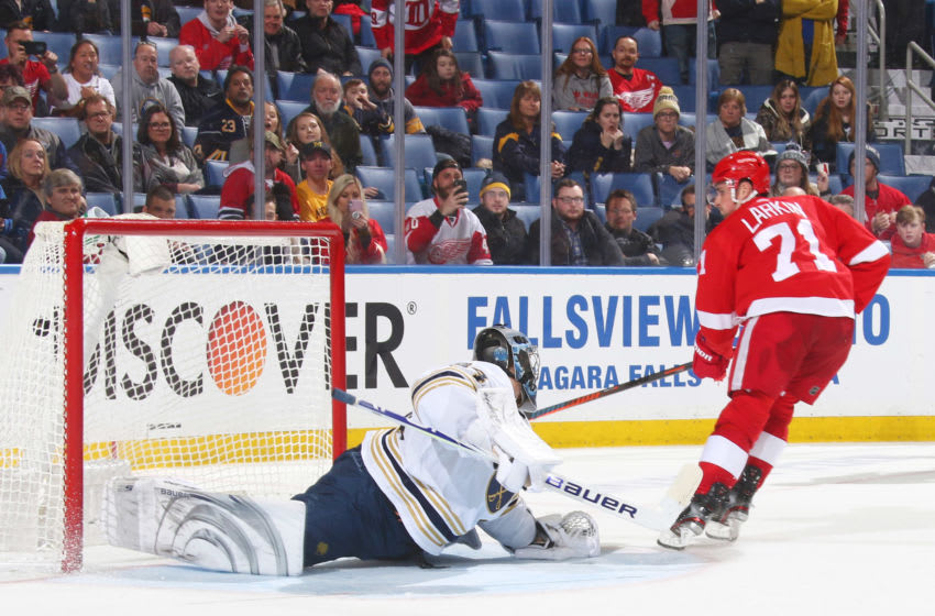 BUFFALO, NY - FEBRUARY 6: Dylan Larkin #71 of the Detroit Red Wings scores a shootout goal against Jonas Johansson #34 of the Buffalo Sabres during an NHL game on February 6, 2020 at KeyBank Center in Buffalo, New York. Detroit won 4-3 in a shootout. (Photo by Rob Marczynski/NHLI via Getty Images)