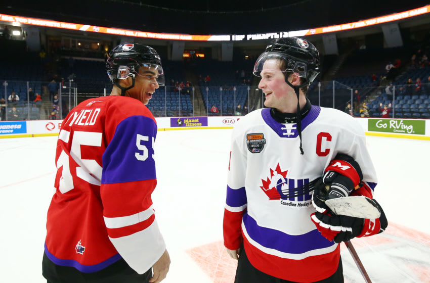 HAMILTON, ON - JANUARY 16: Alexis Lafreniere #11 of Team White and Quinton Byfield #55 of Team Red talk following the final whistle of the 2020 CHL/NHL Top Prospects Game at FirstOntario Centre on January 16, 2020 in Hamilton, Canada. (Photo by Vaughn Ridley/Getty Images)