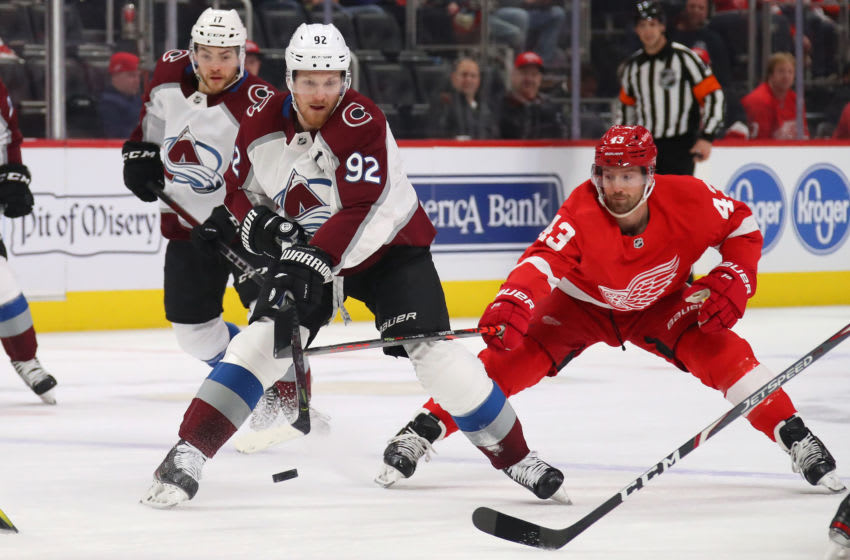 DETROIT, MICHIGAN - MARCH 02: Gabriel Landeskog #92 of the Colorado Avalanche tries to get around the stick of Darren Helm #43 of the Detroit Red Wings during the first period at Little Caesars Arena on March 02, 2020 in Detroit, Michigan. (Photo by Gregory Shamus/Getty Images)