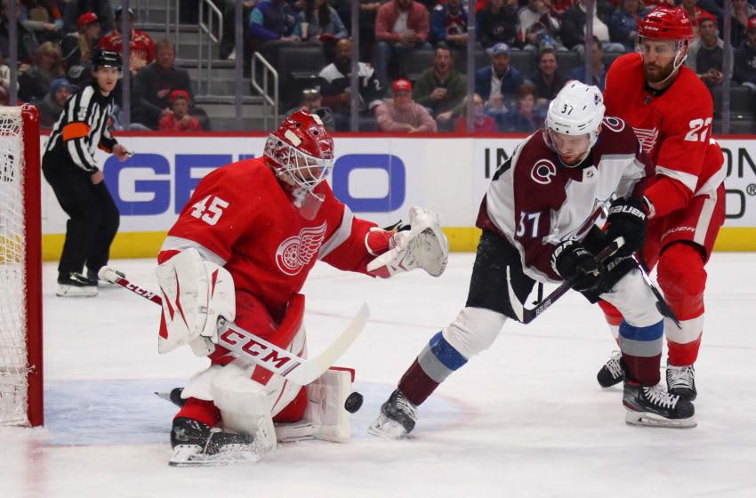 DETROIT, MICHIGAN - MARCH 02: Jonathan Bernier #45 of the Detroit Red Wings makes a stop on a shot by J.T. Compher #37 of the Colorado Avalanche during the first period at Little Caesars Arena on March 02, 2020 in Detroit, Michigan. (Photo by Gregory Shamus/Getty Images)