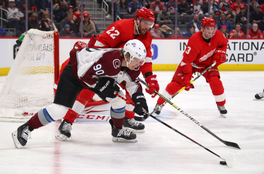 DETROIT, MICHIGAN - MARCH 02: Vladislav Namestnikov #90 of the Colorado Avalanche tries to control the puck next to Patrik Nemeth #22 of the Detroit Red Wings during the third period at Little Caesars Arena on March 02, 2020 in Detroit, Michigan. Colorado won the game 2-1. (Photo by Gregory Shamus/Getty Images)