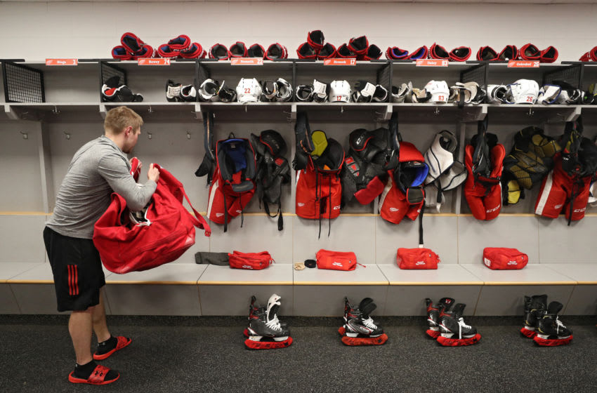 WASHINGTON, DC - MARCH 12: Assistant Equipment Manager Brady Munger of the Detroit Red Wings packs a stick bag after the Detroit Red Wings against the Washington Capitals game was postponed due to the coronavirus at Capital One Arena on March 12, 2020 in Washington, DC. Today the NHL announced is has suspended their season due to the uncertainty of the coronavirus (COVID-19). The NHL currently joins the NBA, MLS, as well as, other sporting events and leagues around the world suspending play because of the coronavirus outbreak. (Photo by Patrick Smith/Getty Images)