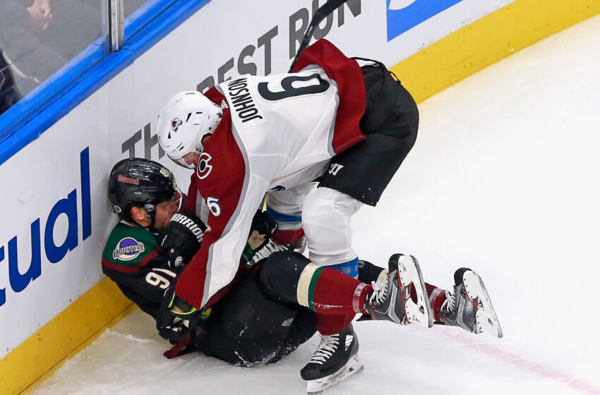 EDMONTON, ALBERTA - AUGUST 15: Erik Johnson #6 of the Colorado Avalanche checks Taylor Hall #91 of the Arizona Coyotes during the first period in Game Three of the Western Conference First Round during the 2020 NHL Stanley Cup Playoffs at Rogers Place on August 15, 2020 in Edmonton, Alberta, Canada. (Photo by Jeff Vinnick/Getty Images)
