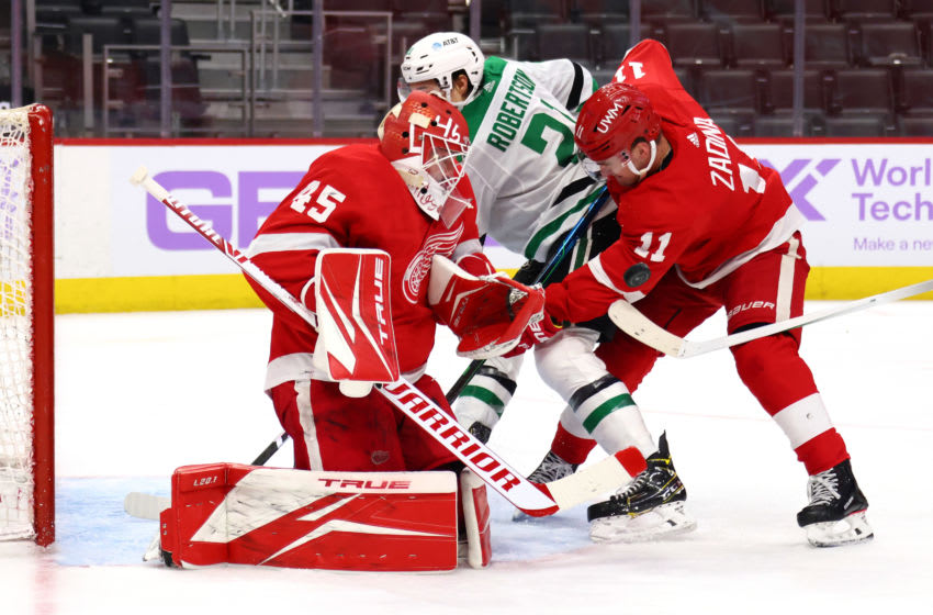 DETROIT, MICHIGAN - APRIL 24: Jonathan Bernier #45 of the Detroit Red Wings makes a save next to Jason Robertson #21 of the Dallas Stars during the third period at Little Caesars Arena on April 24, 2021 in Detroit, Michigan. (Photo by Gregory Shamus/Getty Images)
