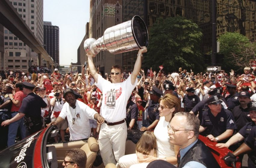 10 Jun 1997: Center Steve Yzerman of the Detroit Red Wings holds the Stanley Cup during the Stanley Cup Victory Parade in Detroit, Michigan. Mandatory Credit: Robert Laberge /Allsport