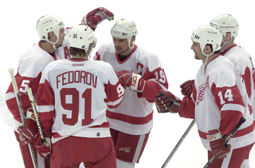 25 APR 2002: Nicklas Lidstrom #5, Sergei Fedorov #91, Steve Yzerman #19, Brendan Shanahan #14, Mathieu Dandenault #11 of the Detroit Red Wings celebrate a goal by Fedorov against the Vancouver Canucks in the first period at Joe Louis Arena in Detroit,Michigan. DIGITAL IMAGE Mandatory Credit: Tom Pidgeon/Getty Images/NHLI