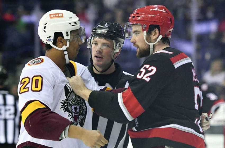 ROSEMONT, IL - DECEMBER 02: Grand Rapids Griffins defenseman Dylan McIlrath (52) and Chicago Wolves right wing Keegan Kolesar (20) fight during the game between the Chicago Wolves and the Grand Rapids Griffins on December 2, 2017 at the Allstate Arena in Rosemont, Illinois. (Photo by Quinn Harris/Icon Sportswire via Getty Images)