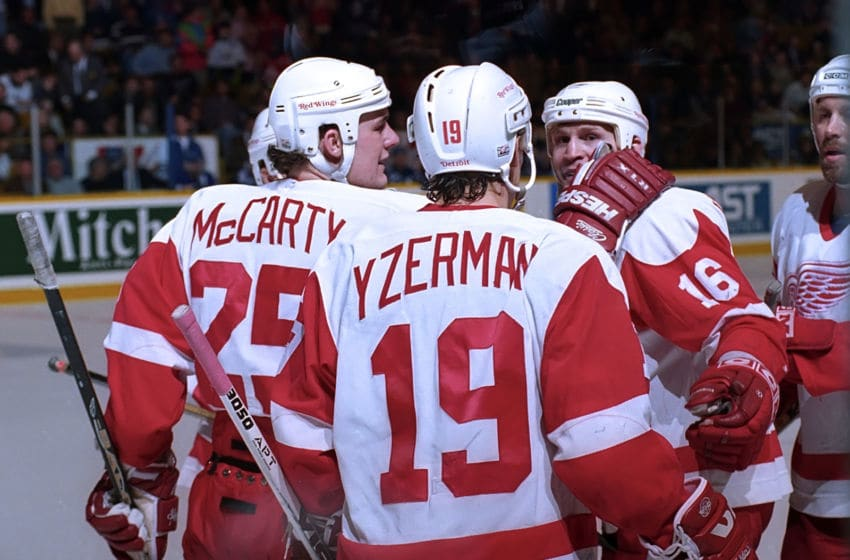 TORONTO, ON - MARCH 20: Darren McCarty #25, Steve Yzerman #19 and Vladimir Konstantinov #16 of the Detroit Red Wings celebrate their win over the Toronto Maple Leafs during NHL game action on March 20, 1996 at Maple Leaf Gardens in Toronto, Ontario, Canada. (Photo by Graig Abel/Getty Images)