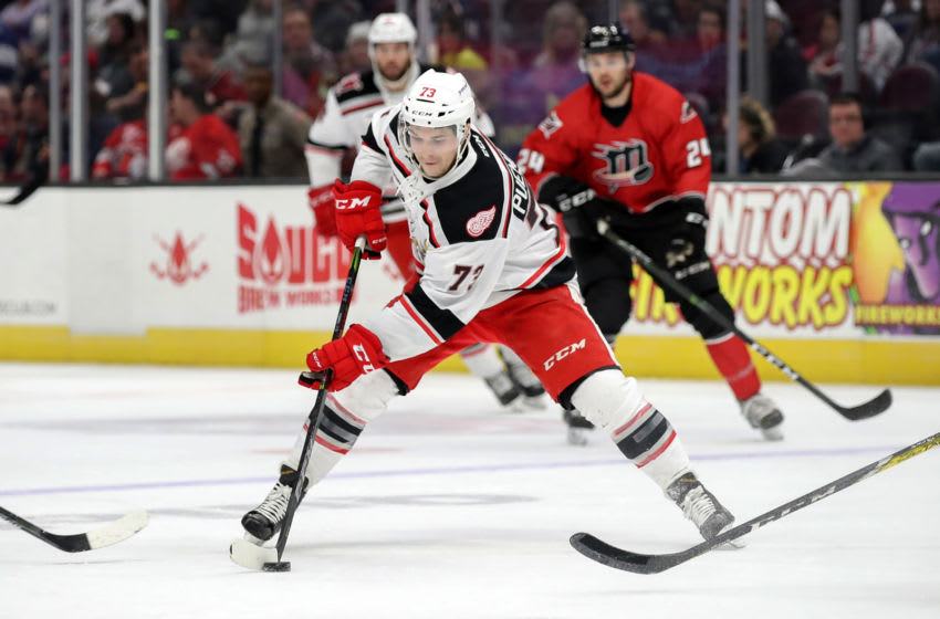 CLEVELAND, OH - FEBRUARY 02: Grand Rapids Griffins left wing Matt Puempel (73) plays the puck during the first period of the American Hockey League game between the Grand Rapids Griffins and Cleveland Monsters on February 2, 2018, at Quicken Loans Arena in Cleveland, OH. Grand Rapids defeated Cleveland 4-2. (Photo by Frank Jansky/Icon Sportswire via Getty Images)