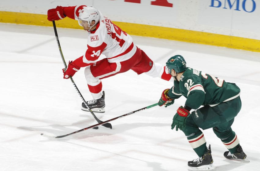 ST. PAUL, MN - MARCH 4: Gustav Nyquist #14 of the Detroit Red Wings shoots the puck with Nino Niederreiter #22 of the Minnesota Wild defending during the game at the Xcel Energy Center on March 4, 2018 in St. Paul, Minnesota. (Photo by Bruce Kluckhohn/NHLI via Getty Images)
