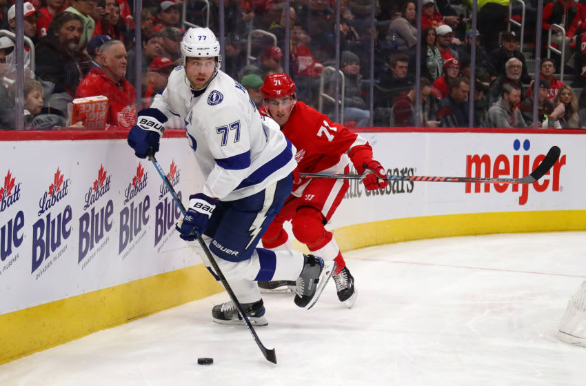 DETROIT, MICHIGAN - DECEMBER 04: Victor Hedman #77 of the Tampa Bay Lightning looks to control the puck in front of Dylan Larkin #71 of the Detroit Red Wings during the second period at Little Caesars Arena on December 04, 2018 in Detroit, Michigan. (Photo by Gregory Shamus/Getty Images)