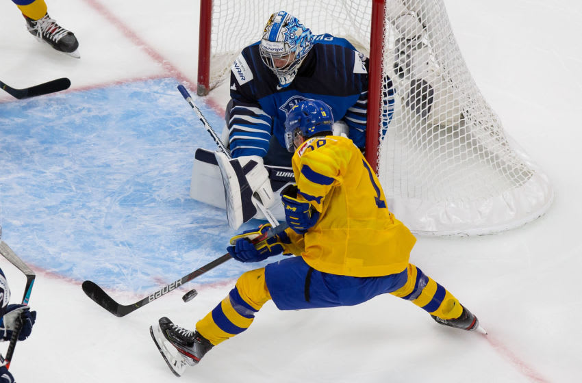 EDMONTON, AB - JANUARY 02: Lucas Raymond #18 of Sweden takes a shot against goaltender Kari Piiroinen #1 of Finland during the 2021 IIHF World Junior Championship quarterfinals at Rogers Place on January 2, 2021 in Edmonton, Canada. (Photo by Codie McLachlan/Getty Images)