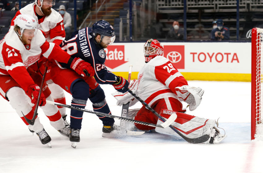 COLUMBUS, OH - APRIL 27: Goaltender Thomas Greiss #29 of the Detroit Red Wings stops a shot by Oliver Bjorkstrand #28 of the Columbus Blue Jackets during the second period at Nationwide Arena on April 27, 2021 in Columbus, Ohio. (Photo by Kirk Irwin/Getty Images)