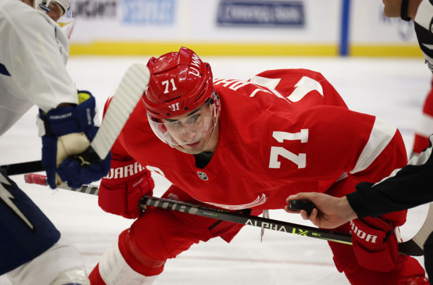 DETROIT, MICHIGAN - MARCH 11: Dylan Larkin #71 of the Detroit Red Wings takes a second period face off against the Tampa Bay Lightning at Little Caesars Arena on March 11, 2021 in Detroit, Michigan. (Photo by Gregory Shamus/Getty Images)