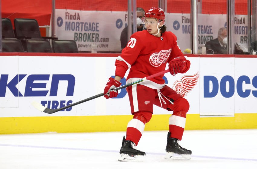 DETROIT, MICHIGAN - MARCH 11: Troy Stecher #70 of the Detroit Red Wings skates against the Tampa Bay Lightning at Little Caesars Arena on March 11, 2021 in Detroit, Michigan. (Photo by Gregory Shamus/Getty Images)