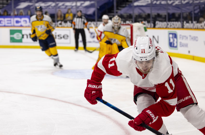 NASHVILLE, TN - MARCH 23: Filip Zadina #11 of the Detroit Red Wings skates the puck in the Nashville Predators end during the second period at Bridgestone Arena on March 23, 2021 in Nashville, Tennessee. (Photo by Brett Carlsen/Getty Images)