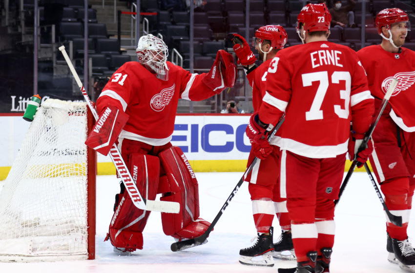 DETROIT, MICHIGAN - MARCH 28: Calvin Pickard #31 of the Detroit Red Wings celebrates a 4-1 win over the Columbus Blue Jackets with teammates at Little Caesars Arena on March 28, 2021 in Detroit, Michigan. (Photo by Gregory Shamus/Getty Images)