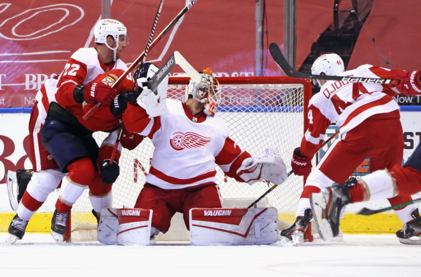 SUNRISE, FLORIDA - MARCH 30: Patrik Nemeth #22, Thomas Greiss #29 and Christian Djoos #44 of the Detroit Red Wings defend against Noel Acciari #55 of the Florida Panthers during the third period at the BB&T Center on March 30, 2021 in Sunrise, Florida. (Photo by Bruce Bennett/Getty Images)