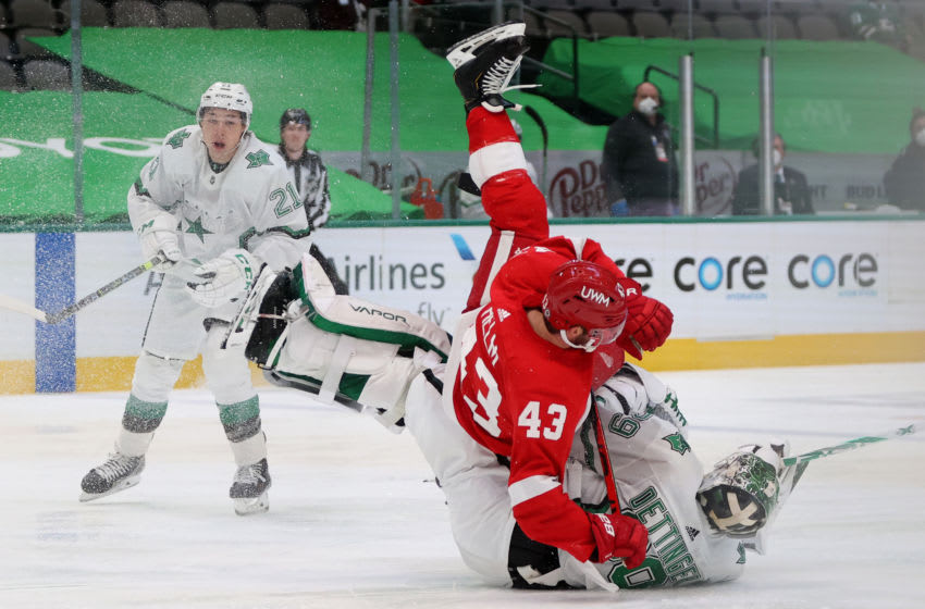 DALLAS, TEXAS - APRIL 20: Jake Oettinger #29 of the Dallas Stars trips Darren Helm #43 of the Detroit Red Wings in the third period at American Airlines Center on April 20, 2021 in Dallas, Texas. (Photo by Ronald Martinez/Getty Images)