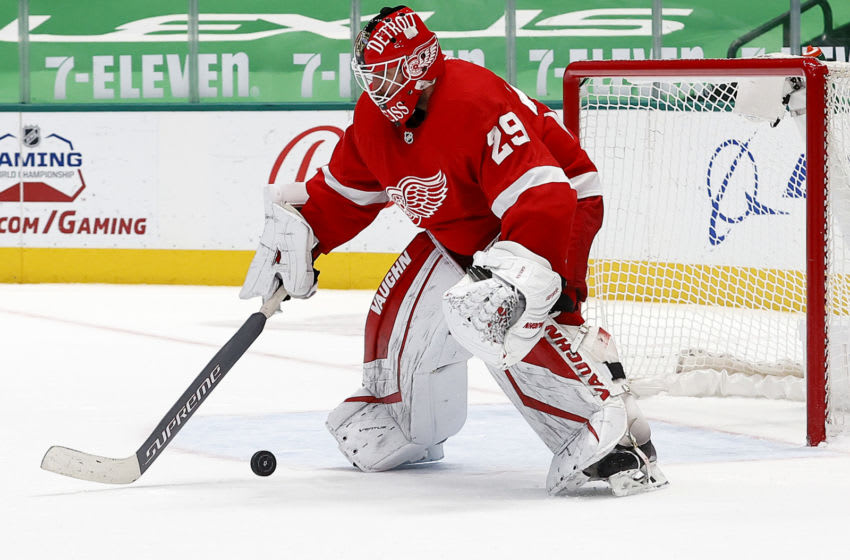 DALLAS, TEXAS - APRIL 19: Thomas Greiss #29 of the Detroit Red Wings blocks a shot on goal against the Dallas Stars in the overtime period at American Airlines Center on April 19, 2021 in Dallas, Texas. (Photo by Tom Pennington/Getty Images)