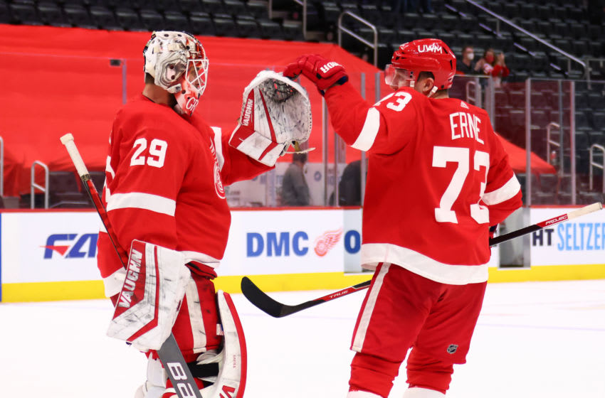 DETROIT, MICHIGAN - MAY 01: Thomas Greiss #29 of the Detroit Red Wings celebrates a 1-0 shootout win over the Tampa Bay Lightning with Adam Erne #73 at Little Caesars Arena on May 01, 2021 in Detroit, Michigan. (Photo by Gregory Shamus/Getty Images)