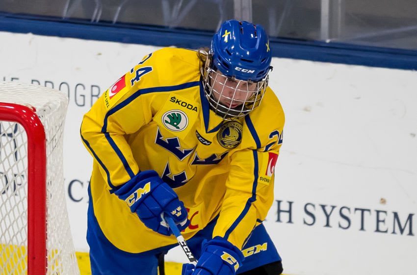 PLYMOUTH, MI - FEBRUARY 15: Albin Grewe #24 of the Sweden Nationals skates around the net with the puck against the Finland Nationals during the 2018 Under-18 Five Nations Tournament game at USA Hockey Arena on February 15, 2018 in Plymouth, Michigan. Finland defeated Sweden 5-3. (Photo by Dave Reginek/Getty Images)*** Local Caption *** Albin Grewe
