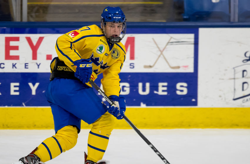 PLYMOUTH, MI - FEBRUARY 15: Jonatan Berggren #17 of the Sweden Nationals skates up ice with the puck against the Finland Nationals during the 2018 Under-18 Five Nations Tournament game at USA Hockey Arena on February 15, 2018 in Plymouth, Michigan. Finland defeated Sweden 5-3. (Photo by Dave Reginek/Getty Images)*** Local Caption *** Jonatan Berggren