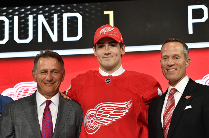 Jun 22, 2018; Dallas, TX, USA; Filip Zadina poses for a photo with team representatives after being selected as the number six overall pick to the Detroit Red Wings in the first round of the 2018 NHL Draft at American Airlines Center. Mandatory Credit: Jerome Miron-USA TODAY Sports