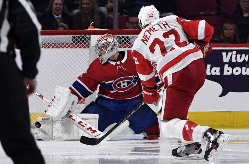 Oct 10, 2019; Montreal, Quebec, CAN; Montreal Canadiens goalie Carey Price (31) makes a pad save against Detroit Red Wings defenseman Patrick Nemeth (22) during the third period at the Bell Centre. Mandatory Credit: Eric Bolte-USA TODAY Sports
