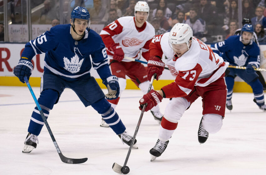 Dec 21, 2019; Toronto, Ontario, CAN; Detroit Red Wings left wing Adam Erne (73) skates with the puck as Toronto Maple Leafs right wing Ilya Mikheyev (65) tries to defend during the second period at Scotiabank Arena. Mandatory Credit: Nick Turchiaro-USA TODAY Sports