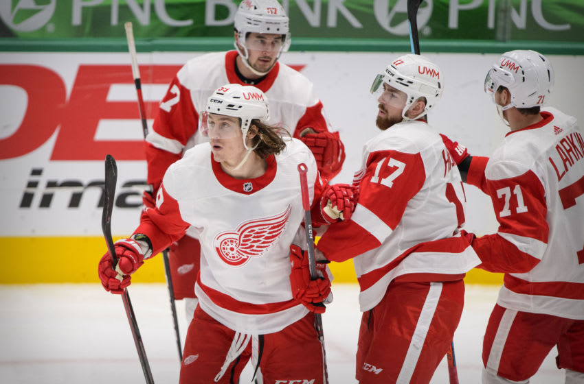 Jan 28, 2021; Dallas, Texas, USA; Detroit Red Wings left wing Tyler Bertuzzi (59) and defenseman Filip Hronek (17) and center Dylan Larkin (71) celebrates a goal scored by Bertuzzi against the Dallas Stars during the third period at the American Airlines Center. Mandatory Credit: Jerome Miron-USA TODAY Sports