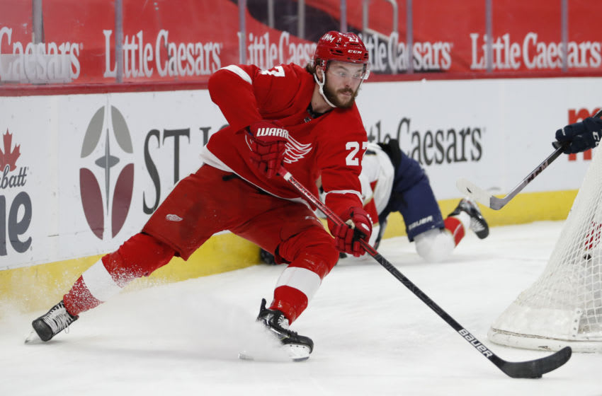 Jan 31, 2021; Detroit, Michigan, USA; Detroit Red Wings center Michael Rasmussen (27) skates with the puck behind the net during the second period against the Florida Panthers at Little Caesars Arena. Mandatory Credit: Raj Mehta-USA TODAY Sports