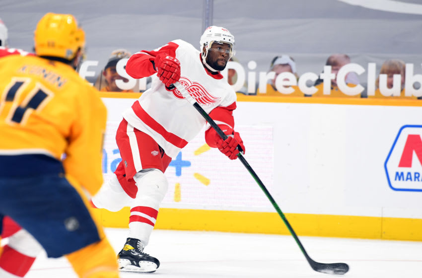 Feb 11, 2021; Nashville, Tennessee, USA; Detroit Red Wings left wing Givani Smith (48) attempts a shot during the second period against the Nashville Predators at Bridgestone Arena. Mandatory Credit: Christopher Hanewinckel-USA TODAY Sports