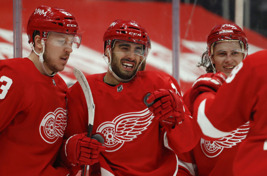 Mar 18, 2021; Detroit, Michigan, USA; Detroit Red Wings center Robby Fabbri (14) celebrates with teammates after scoring a goal during the second period against the Dallas Stars at Little Caesars Arena. Mandatory Credit: Raj Mehta-USA TODAY Sports