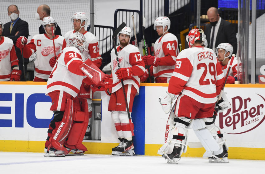 Mar 25, 2021; Nashville, Tennessee, USA; Detroit Red Wings goaltender Thomas Greiss (29) is pulled from the game for Detroit Red Wings goaltender Calvin Pickard (31) during the first period against the Nashville Predators at Bridgestone Arena. Mandatory Credit: Christopher Hanewinckel-USA TODAY Sports