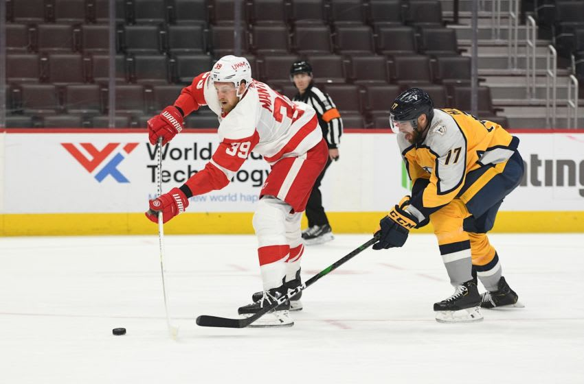 Apr 6, 2021; Detroit, Michigan, USA; Detroit Red Wings right wing Anthony Mantha (39) shoots as Nashville Predators defenseman Ben Harpur (17) defends during the second period at Little Caesars Arena. Mandatory Credit: Tim Fuller-USA TODAY Sports