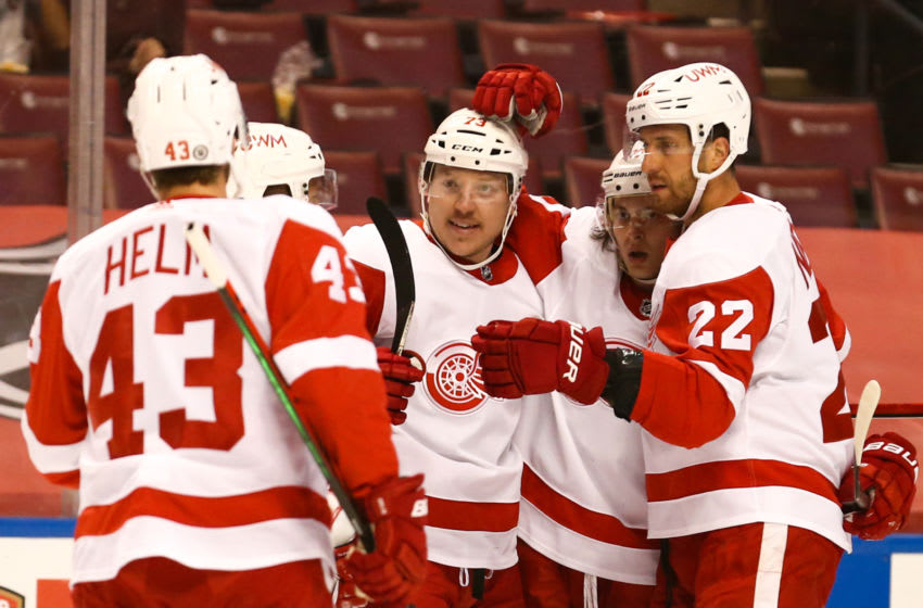 Apr 1, 2021; Sunrise, Florida, USA; Detroit Red Wings left wing Adam Erne (73) celebrates with left wing Darren Helm (43) and defenseman Patrik Nemeth (22) and defenseman Troy Stecher (70) after scoring against the Florida Panthers during the first period at BB&T Center. Mandatory Credit: Sam Navarro-USA TODAY Sports
