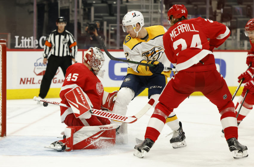 Apr 8, 2021; Detroit, Michigan, USA; Detroit Red Wings goaltender Jonathan Bernier (45) makes the save on Nashville Predators defenseman Tyler Lewington (2) defended by defenseman Jon Merrill (24) in the third period at Little Caesars Arena. Mandatory Credit: Rick Osentoski-USA TODAY Sports