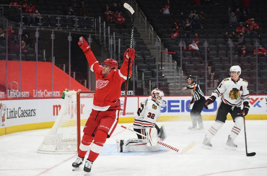 Apr 15, 2021; Detroit, Michigan, USA; Detroit Red Wings left wing Jakub Vrana (15) celebrates his goal on Chicago Blackhawks goaltender Kevin Lankinen (32) during the second period at Little Caesars Arena. Mandatory Credit: Tim Fuller-USA TODAY Sports