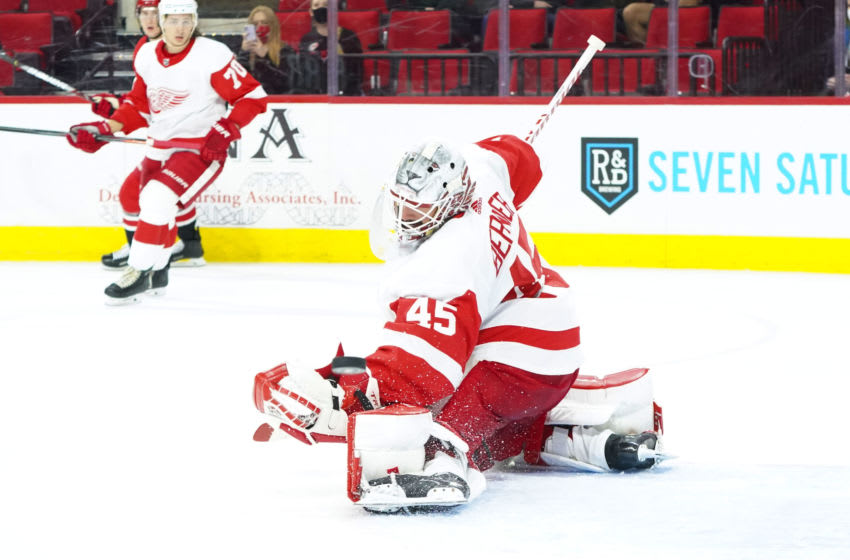 Apr 29, 2021; Raleigh, North Carolina, USA; Detroit Red Wings goaltender Jonathan Bernier (45) reaches out to make a save during the third period against the Carolina Hurricanes at PNC Arena. Mandatory Credit: James Guillory-USA TODAY Sports