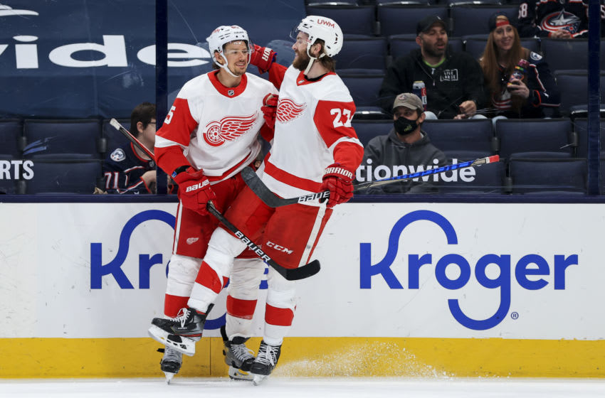 May 8, 2021; Columbus, Ohio, USA; Detroit Red Wings defenseman Danny DeKeyser (left) celebrates with teammate center Michael Rasmussen (27) after scoring a goal against the Columbus Blue Jackets in the second period at Nationwide Arena. Mandatory Credit: Aaron Doster-USA TODAY Sports