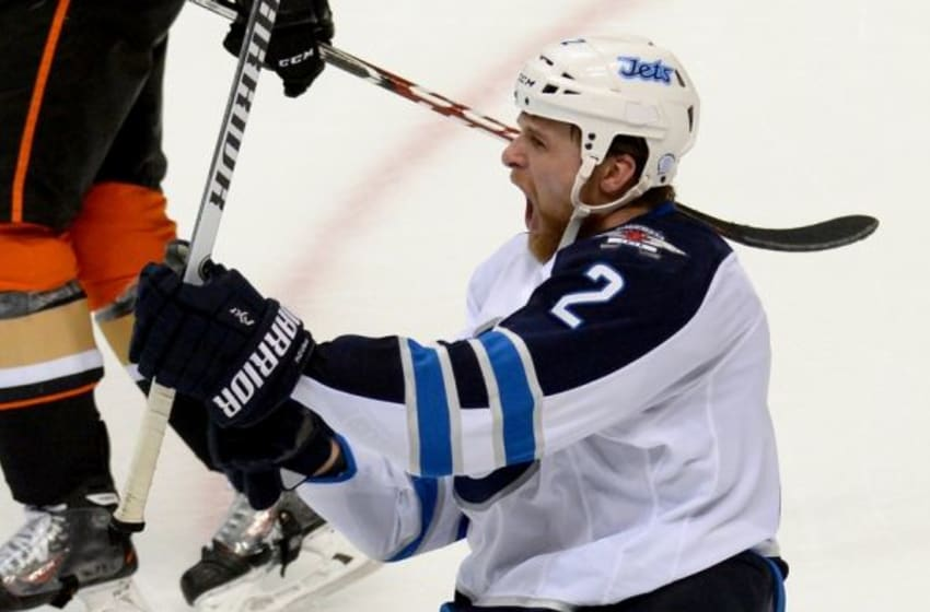 Apr 18, 2015; Anaheim, CA, USA; Winnipeg Jets defenseman Adam Pardy (2) celebrates a goal in the second period of game two of the first round of the the 2015 Stanley Cup Playoffs against the Anaheim Ducks at Honda Center. Mandatory Credit: Jayne Kamin-Oncea-USA TODAY Sports