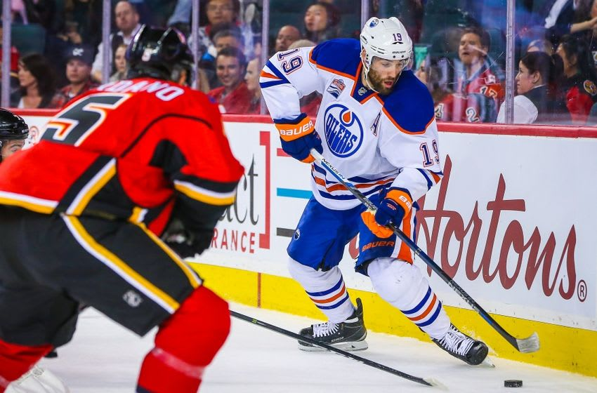 Sep 26, 2016; Calgary, Alberta, CAN; Edmonton Oilers left wing Patrick Maroon (19) controls the puck against the Calgary Flames during a preseason hockey game at Scotiabank Saddledome. Mandatory Credit: Sergei Belski-USA TODAY Sports